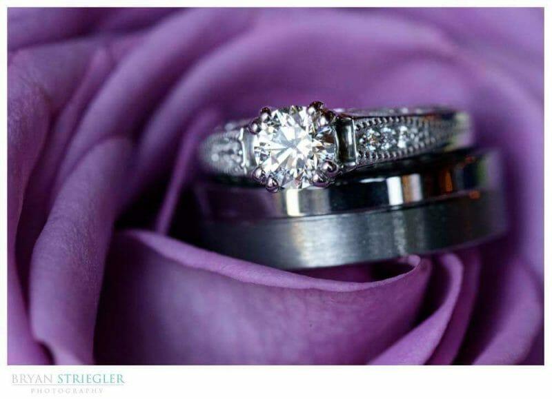 macro shot of wedding ring in a purple flower