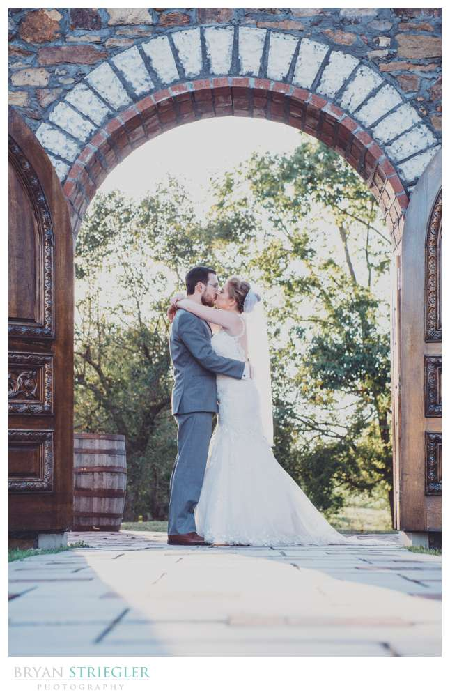 couple in the doorway of the chapel ruins