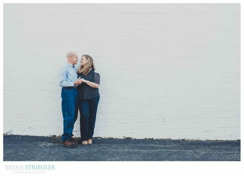 engagement photo with white wall