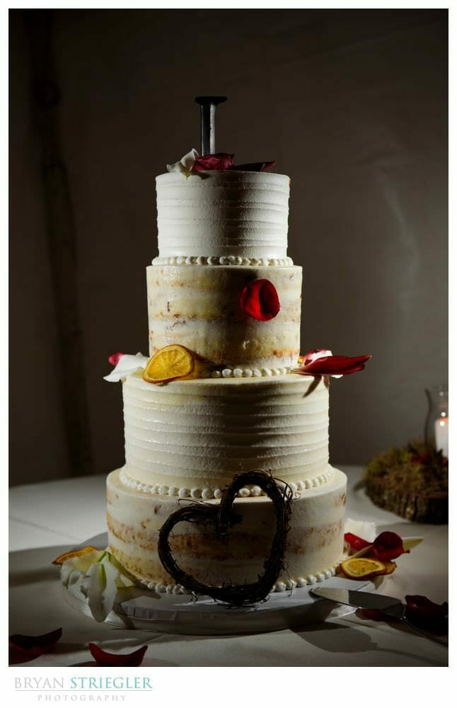 Rustic wedding cake with dramatic lighting