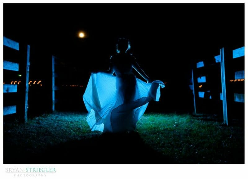 rustic wedding with bride dancing in the dark with full moon