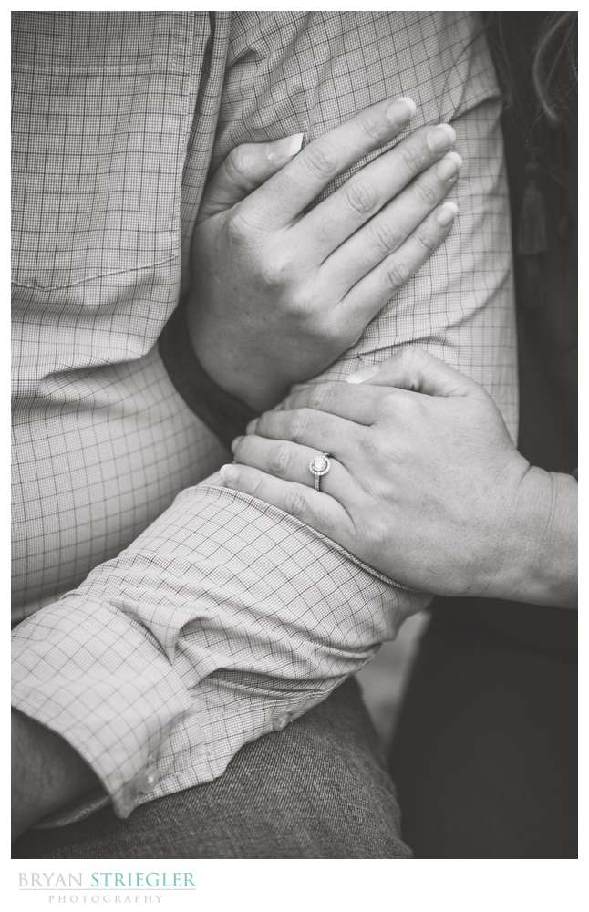 close up of couples arms and wedding ring