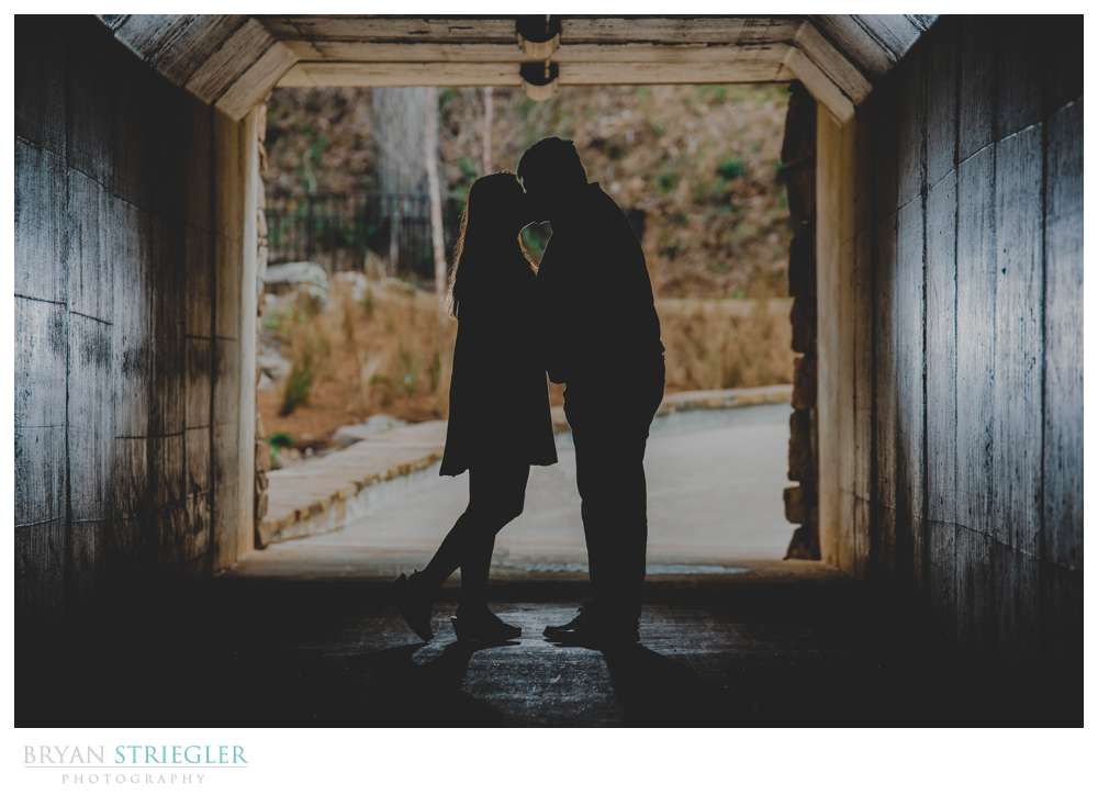 silhouette engagement photo in tunnel