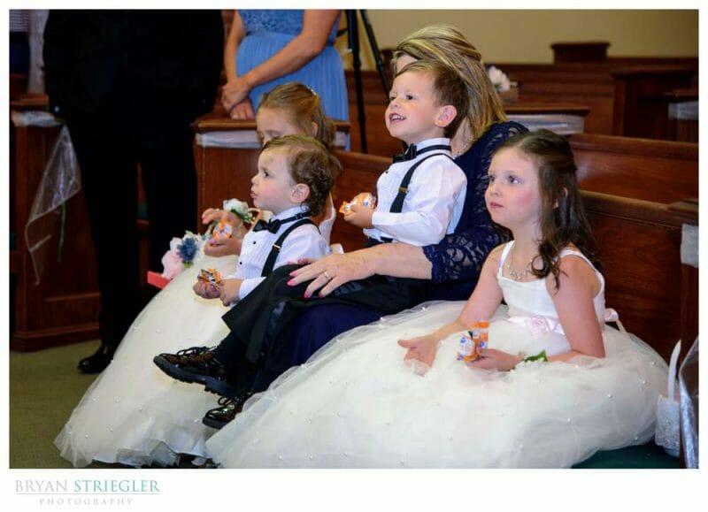 ringer bearer and flower girls at a wedding