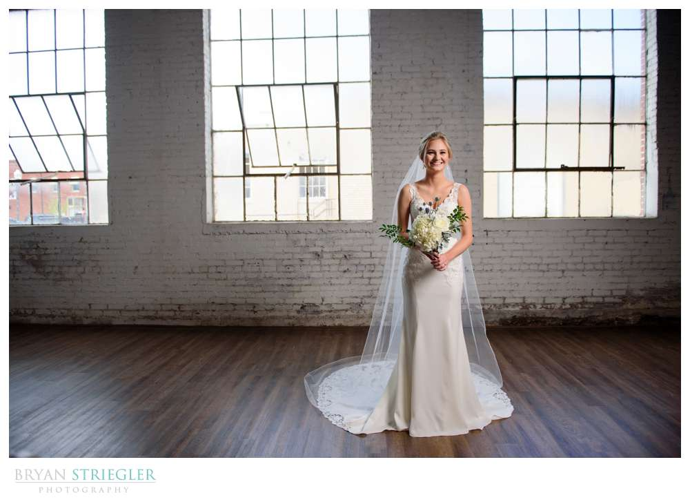 bridal portrait in front of large windows