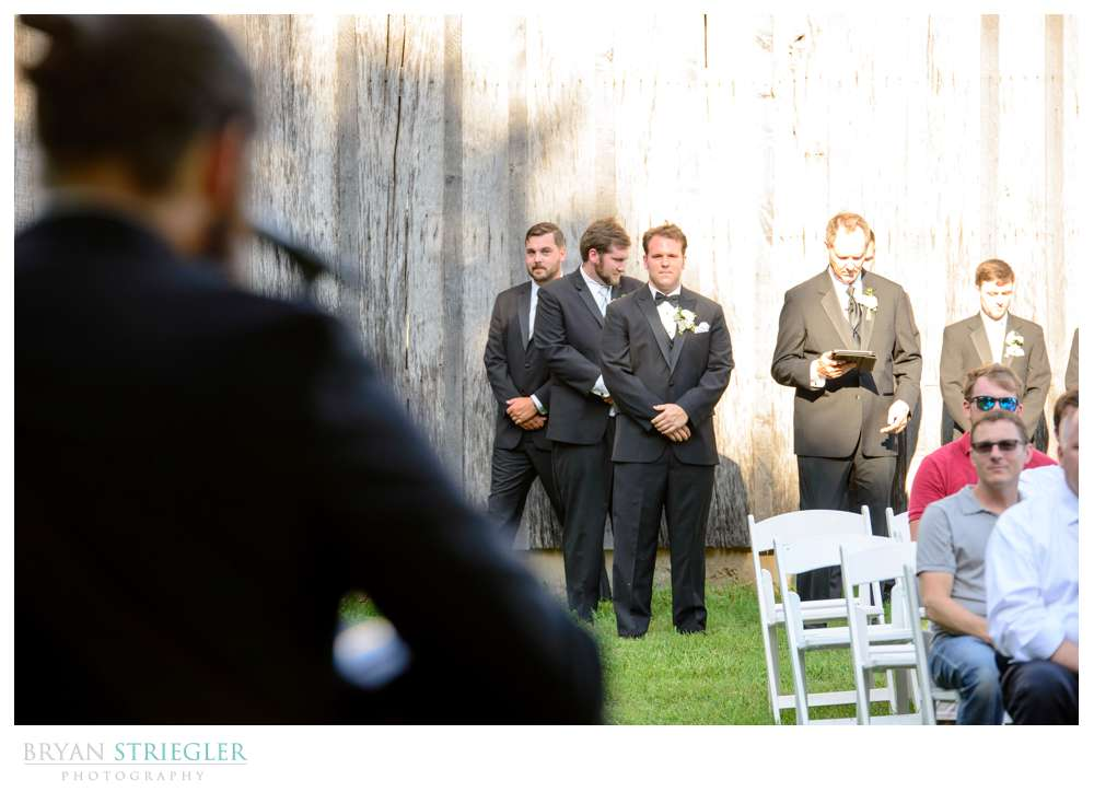 brother of the groom playing a song
