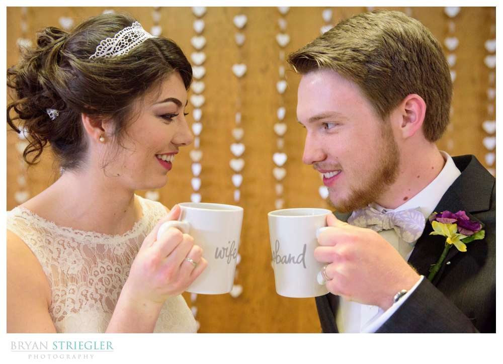 bride and groom with custom coffee cups