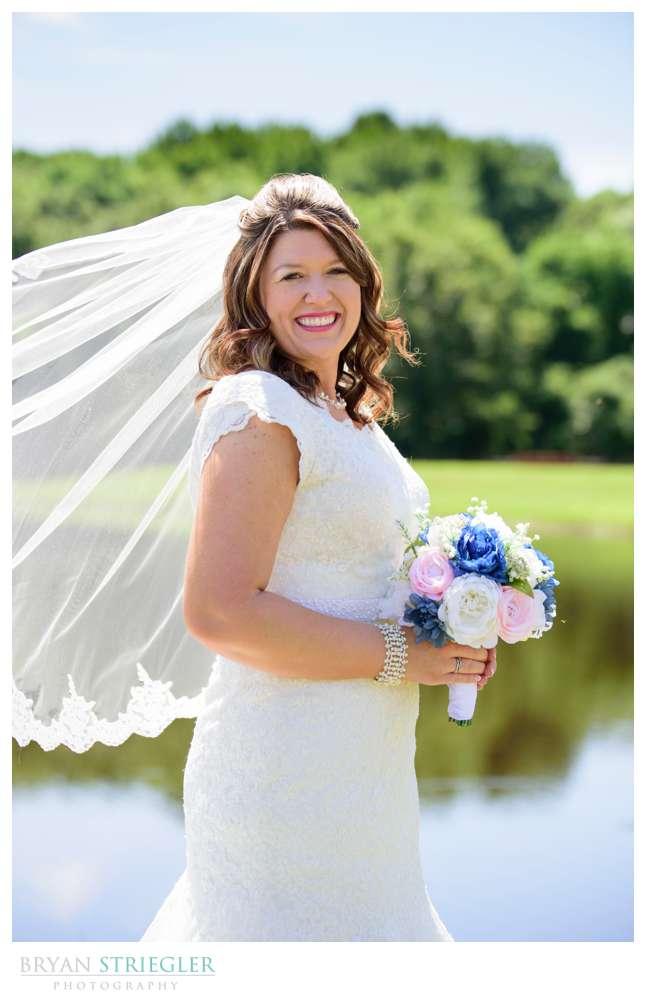 bridal portrait by pond in Van Buren
