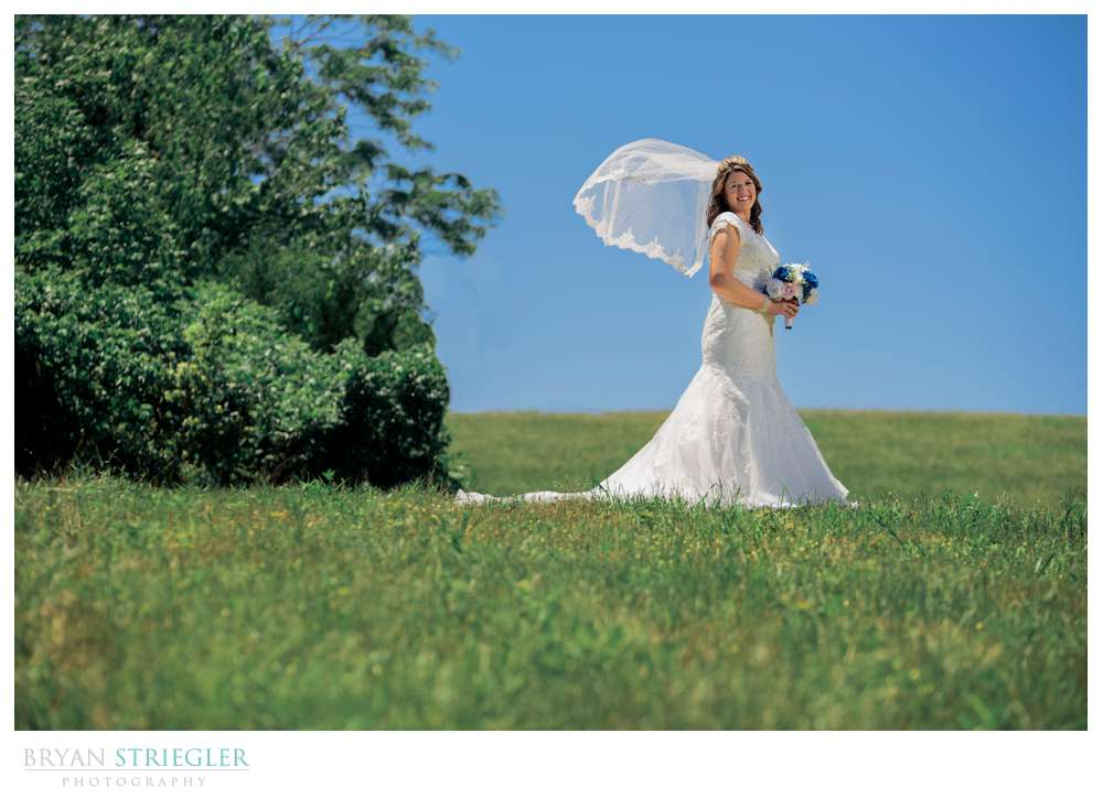 bride on hill with vail
