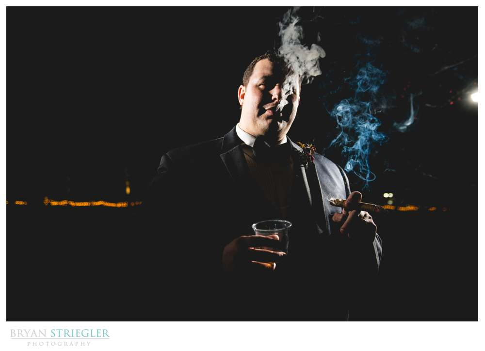 groom with cigar and whiskey