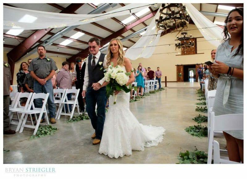 bride walking down the aisle at Rockford Grange