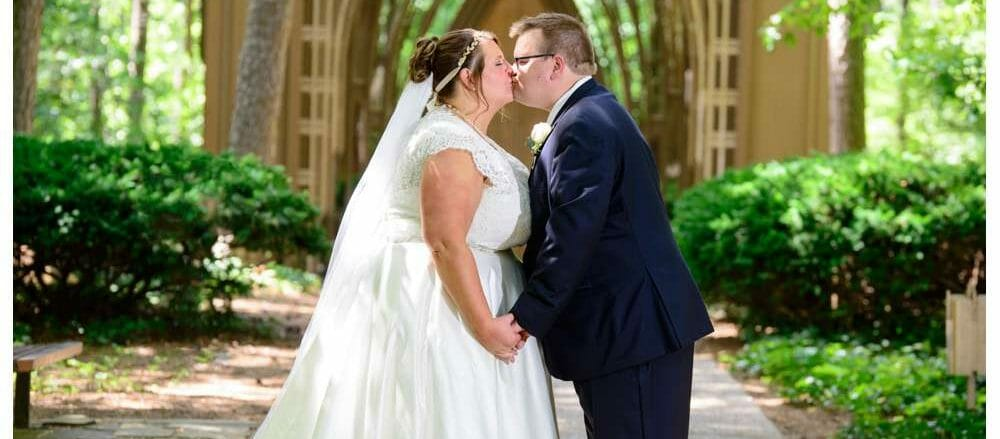 kissing in front of Mildred B. Cooper Chapel