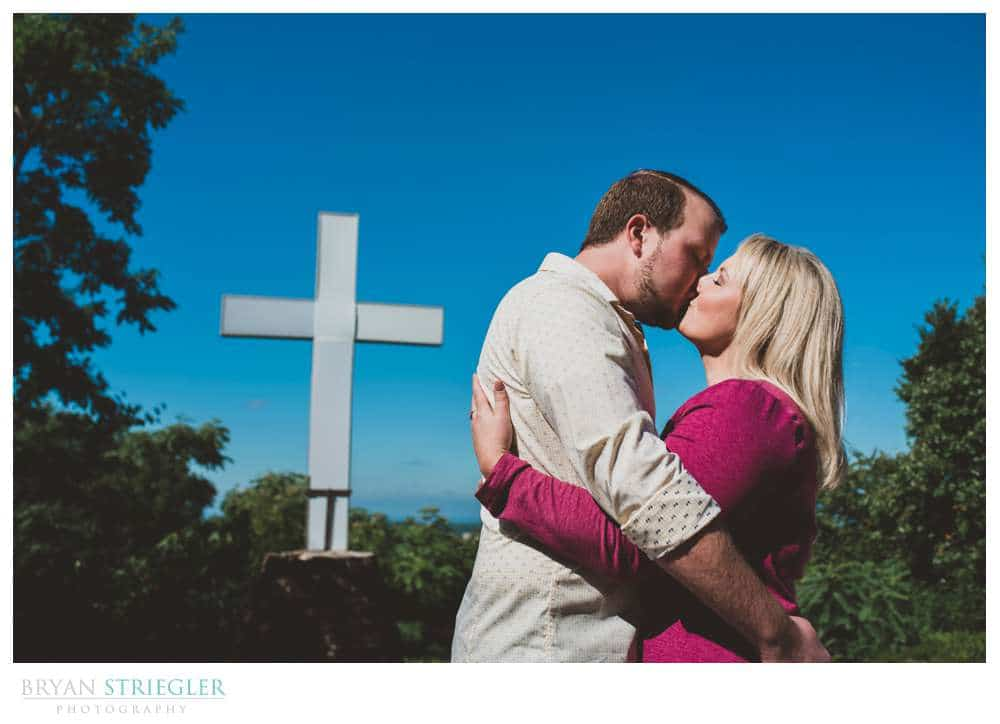 proposal photos in front of giant cross