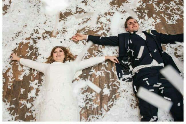 couple making confetti angels