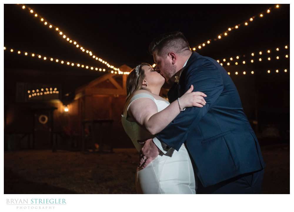 couple portrait with lights at the Barn at the Springs