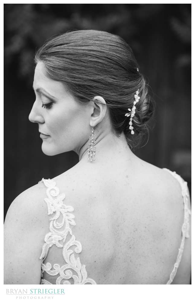 black and white photo of back of bride