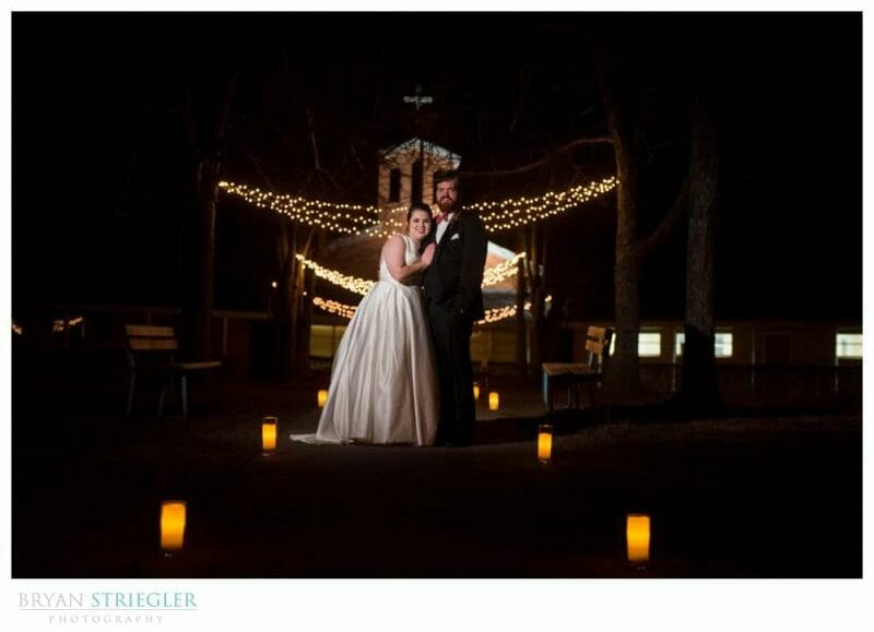 wedding couple in front of christmas lights