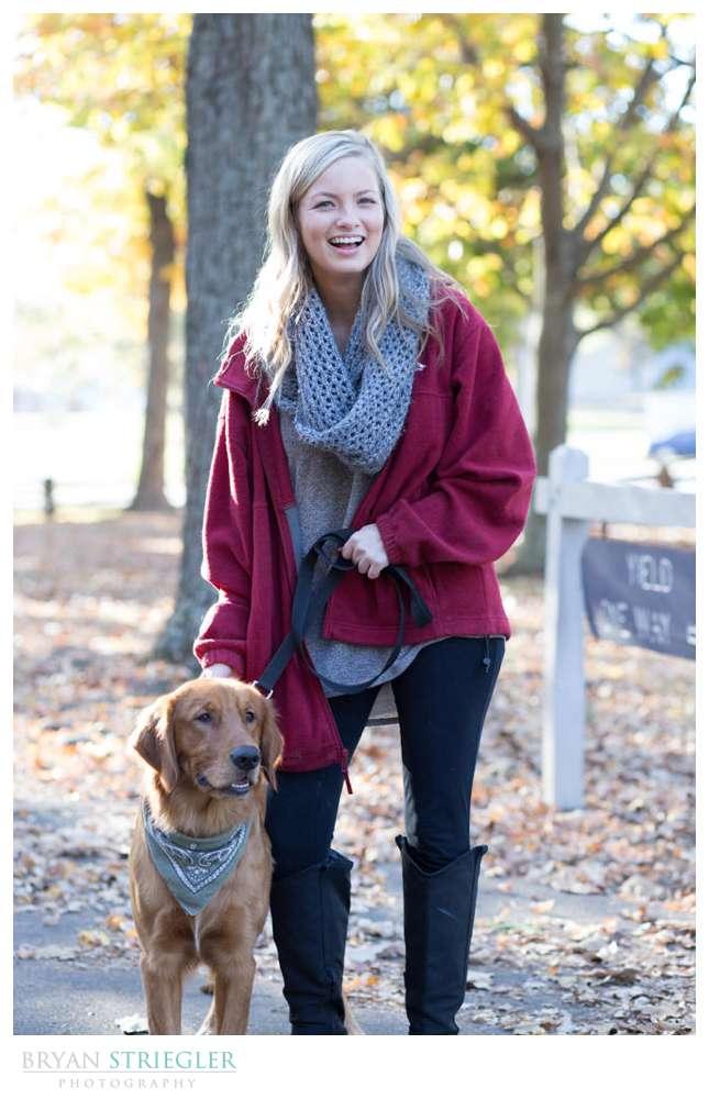 helper holding dog at engagement shoot