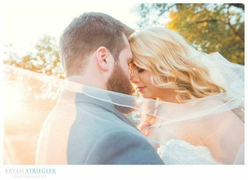 wedding couple with veil and bright sun