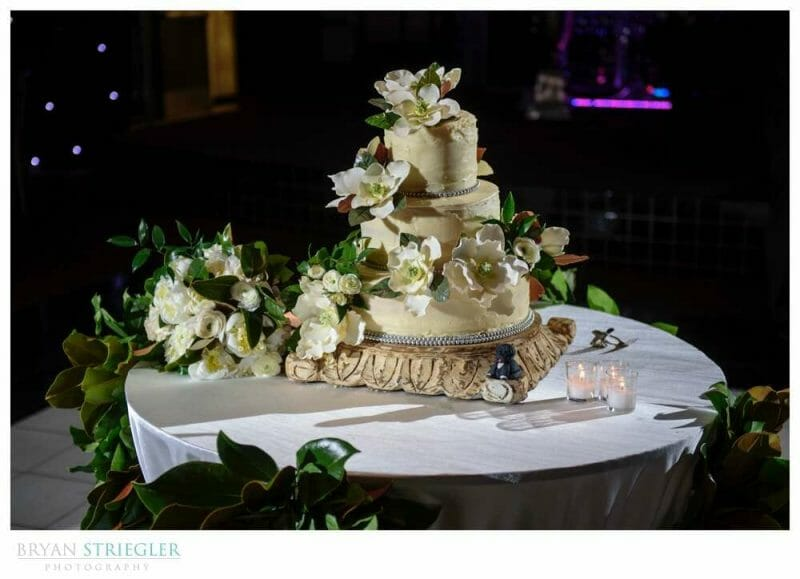wedding cake with lots of flowers