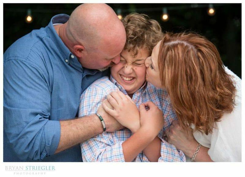 engagement photo kissing son on both cheeks