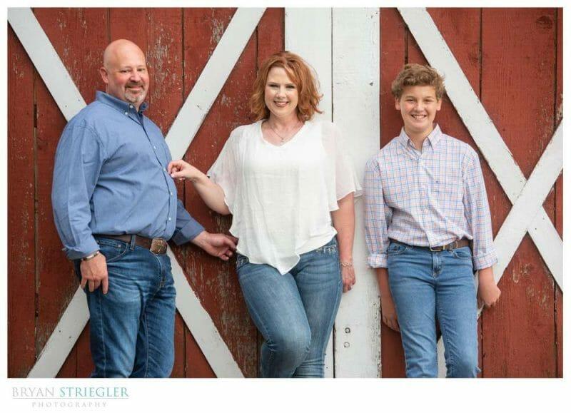 engagement photo in front of barn door
