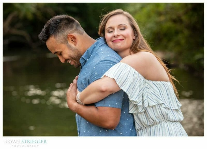 hugging fiance in photos