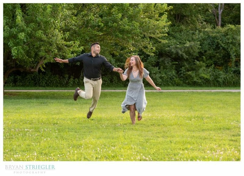 funny couple running through a field