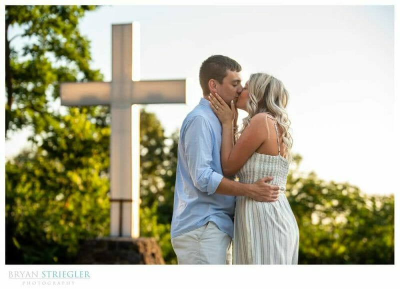 kissing in front of cross at Mount Sequoyah