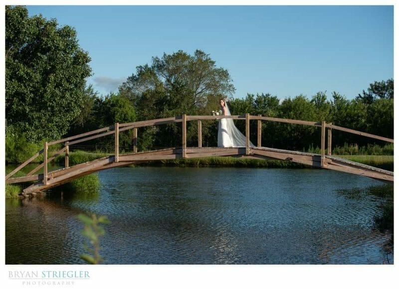 bride on bridge at the Orchard
