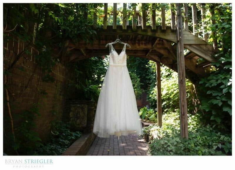 wedding dress hanging on bridge