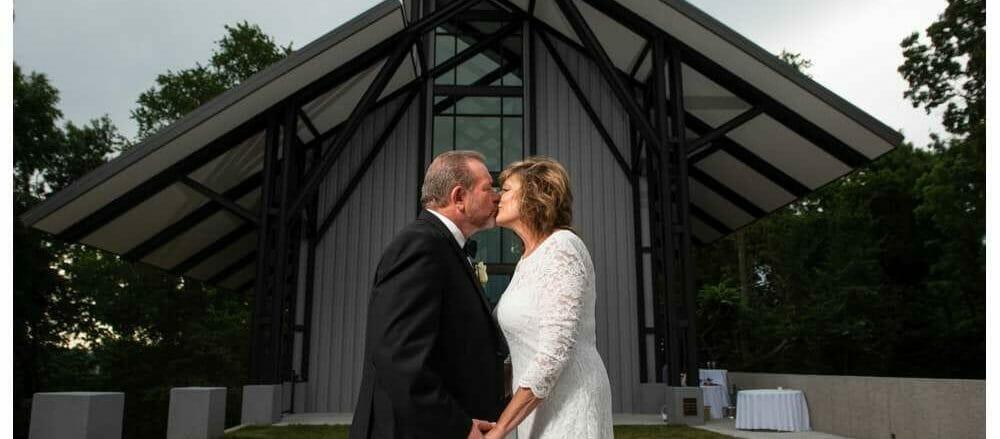 couple outside of the CLC glass chapel