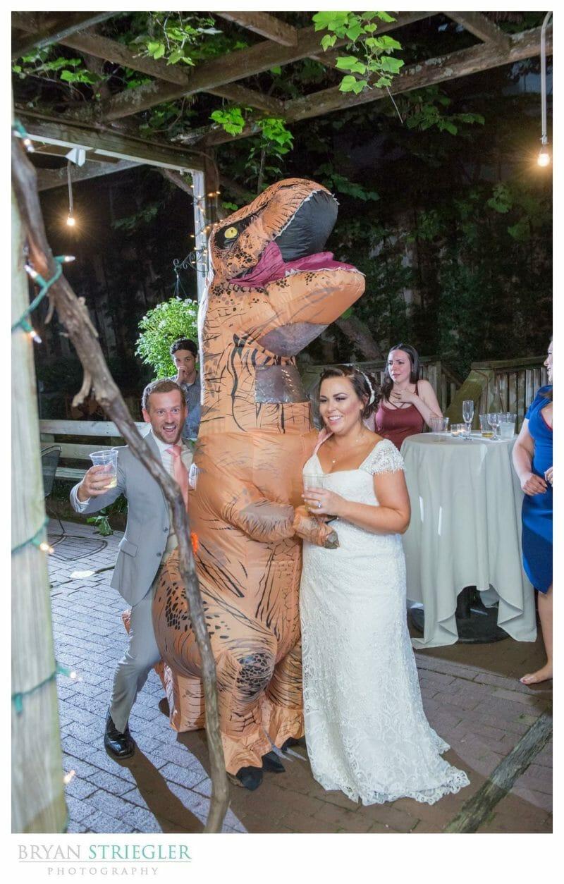 wedding guest in dinosaur costume