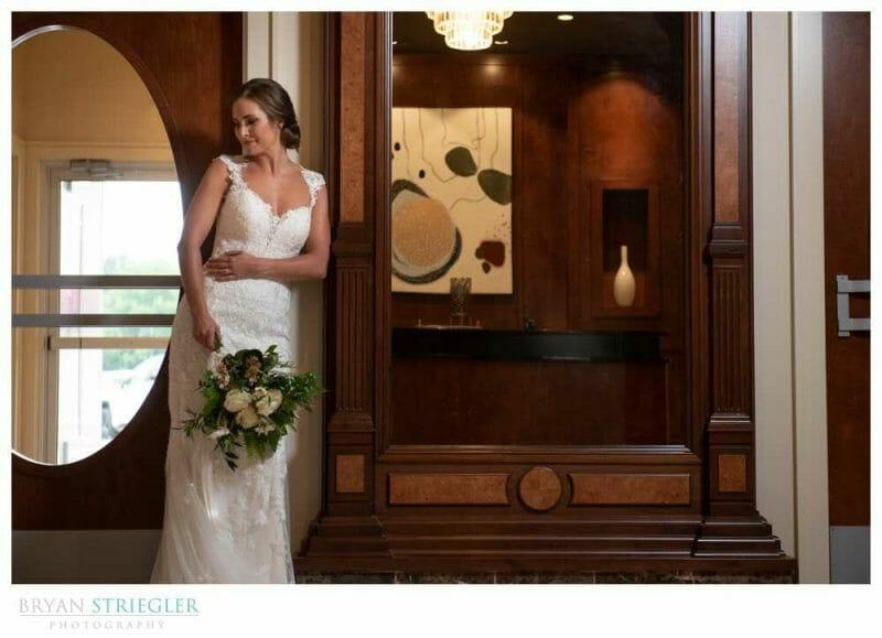 bride against mirror