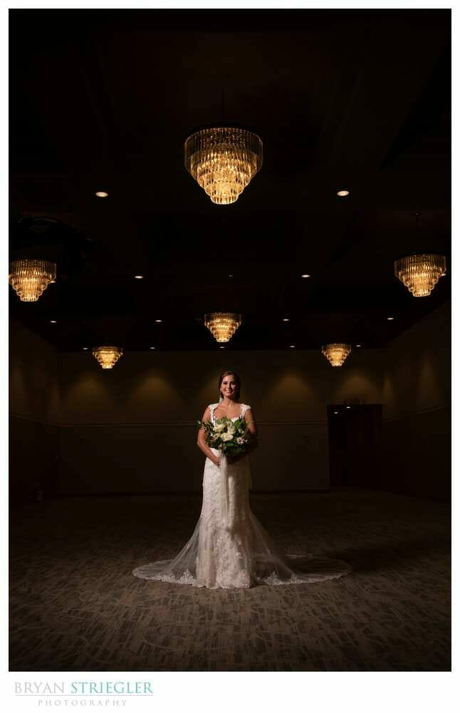 dramatic bridal portrait with chandeliers