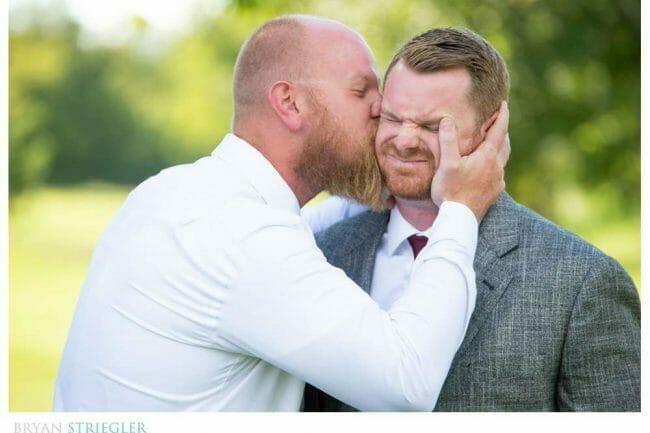 groomsman kissing groom
