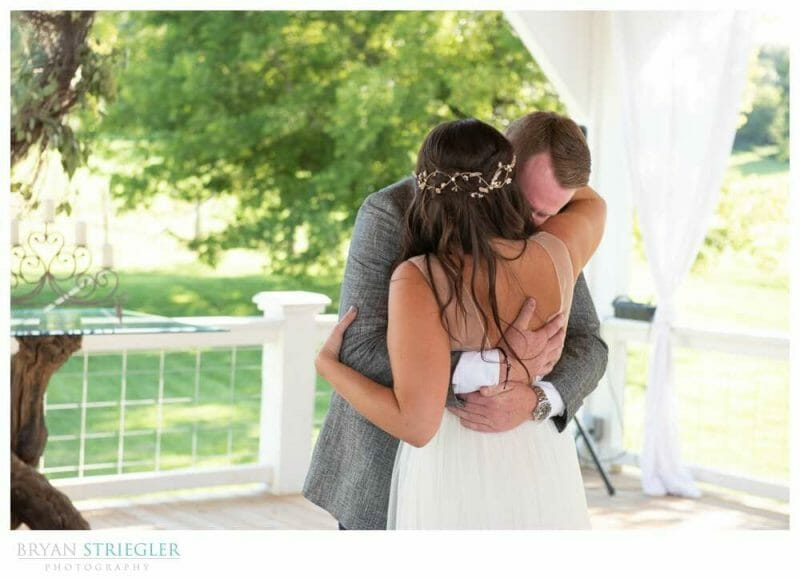 groom getting emotional during first look