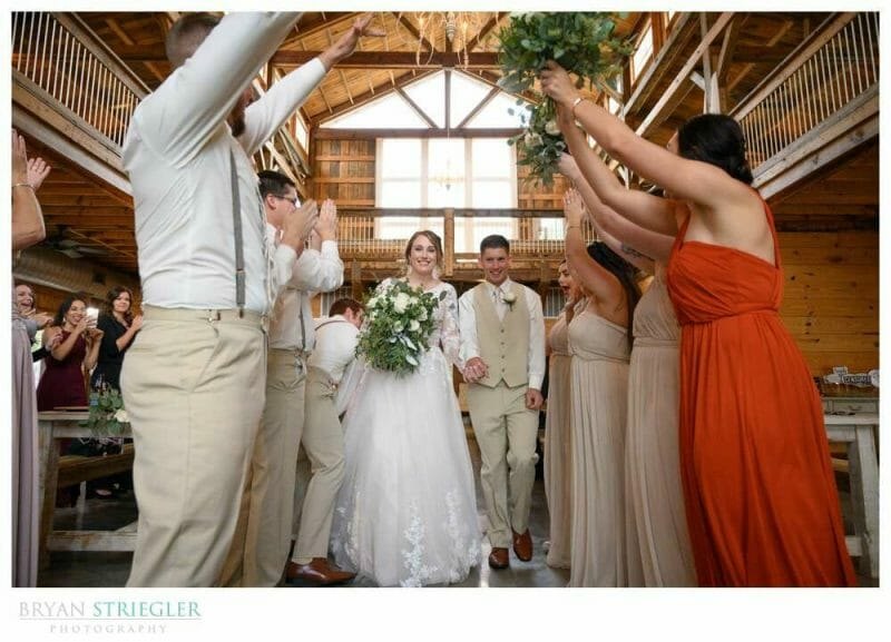 wedding entrance through crowd