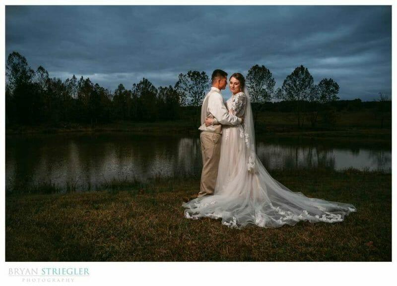 dramatic wedding portrait by pond