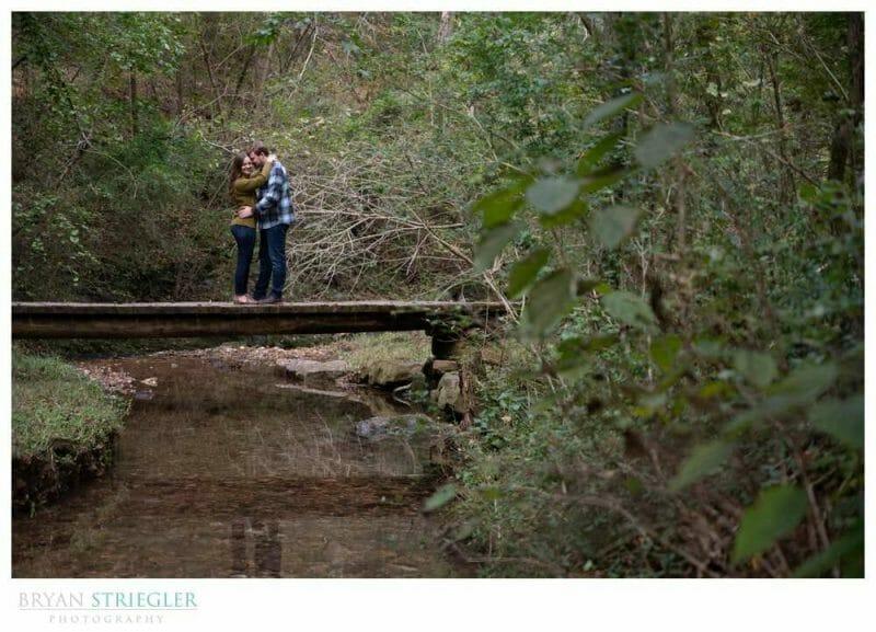couple on bridge over creek
