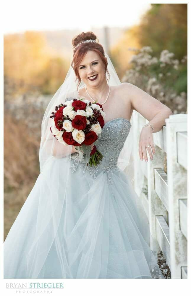 bride leaning on a fence