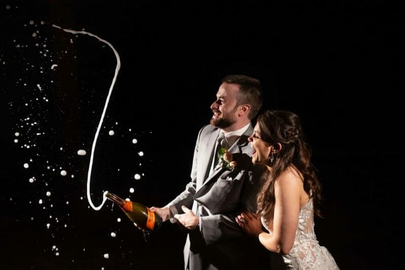 couple shooting champagne