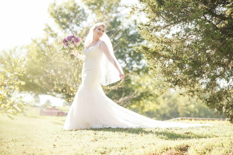 bride in field at Sassafras Springs Vineyard