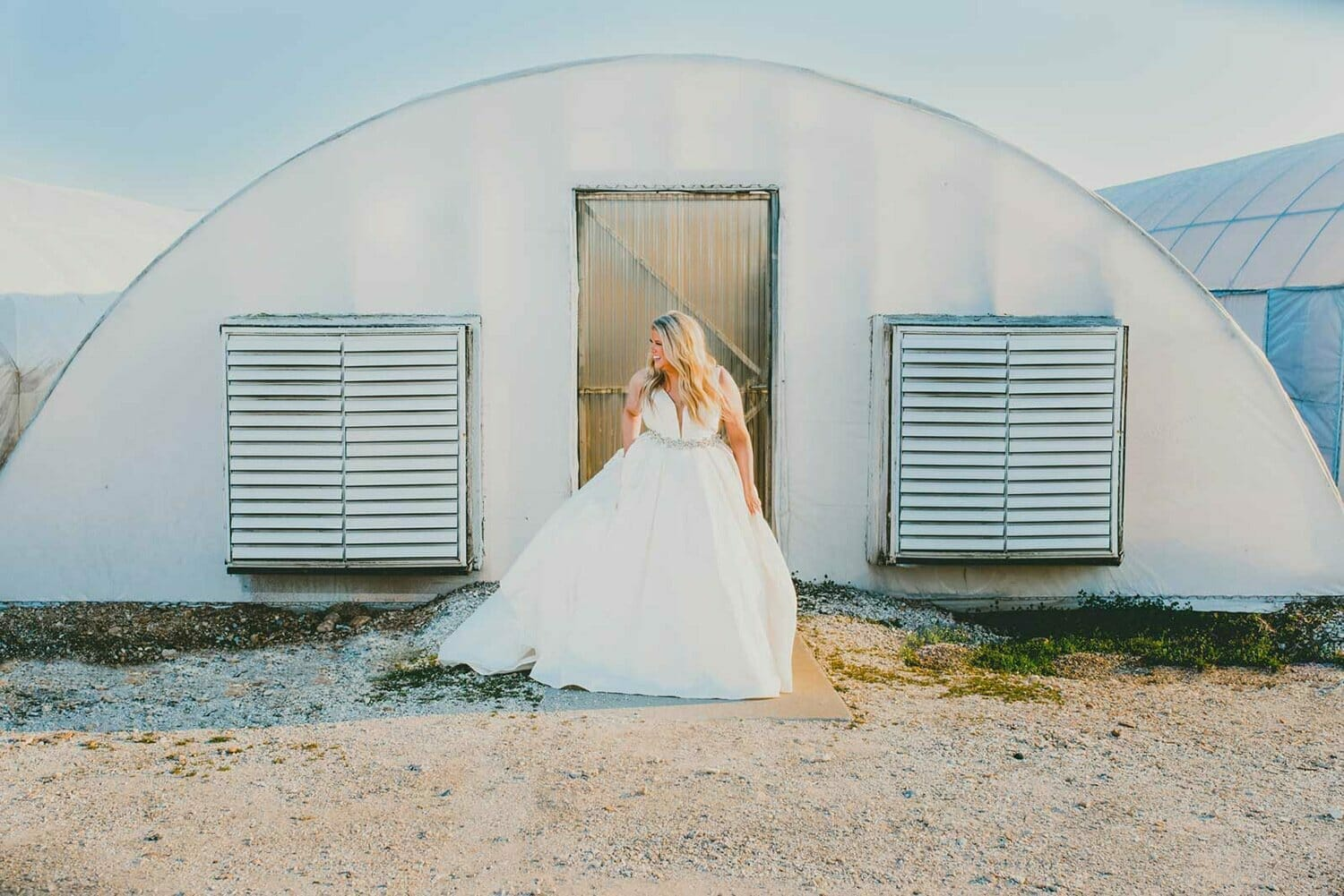 bridal portrait in front of greenhouse