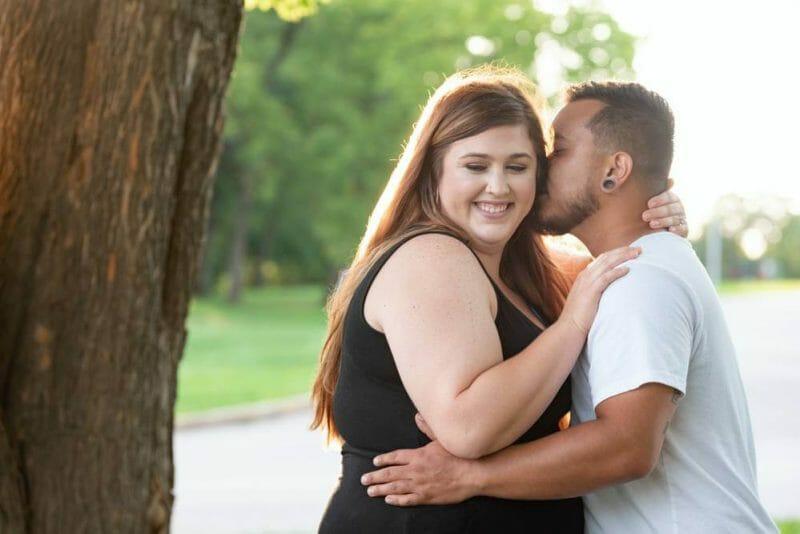 guy kissing girl on the cheek in Kansas City