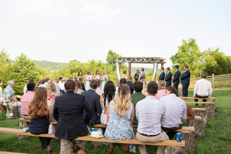 wide shot of wedding ceremony at Under the Woods wedding venue