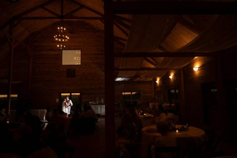 wide shot of first dance inside Under the Woods