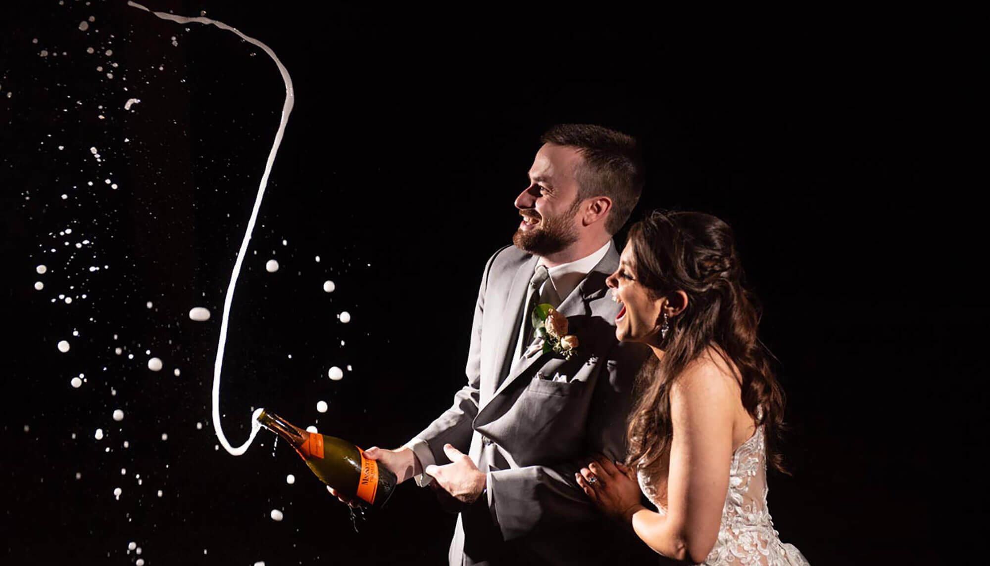 popping champagne wedding celebration northwest arkansas wedding photographer striegler photo