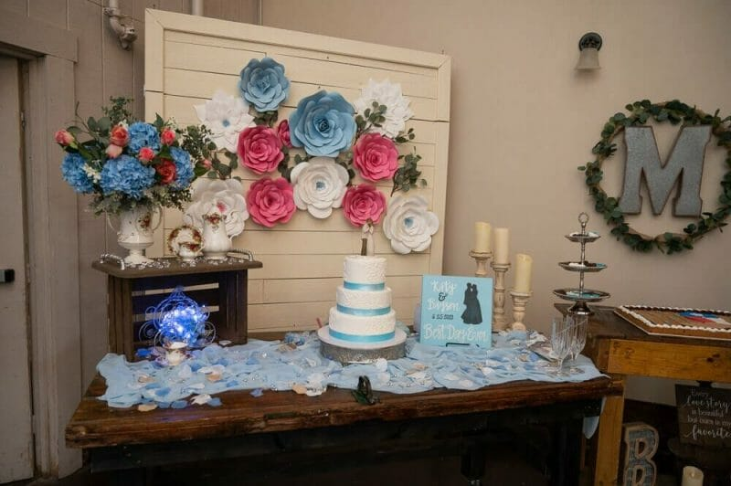 table with flower and wedding cake