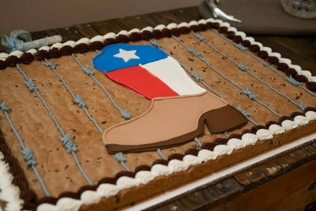 grooms cake with cowboy boot and Texas flag